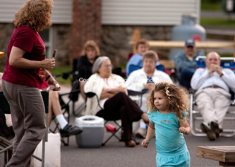 OXFORD, CT- MAY 28, 2010-052810JS04-FOR COUNTRY LIFE-Three-year-old Jaden Rogers of Oxford dances with her grandmother Nancy Rogers of Oxford, left, to the sounds of The Golden Ages Jazz Band during the Memorial Weekend concert at the Gazebo at Center School in Oxford. The concert was hosted by the Oxford Cultural Arts Commission.<br /> Jim Shannon Republican-American