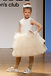 Model walks runway in an outfit from the Sorci & Fofa collection during the petitePARADE fashion show at Children's Club in the Jacob Javits Center in New York City on February 25, 2018.