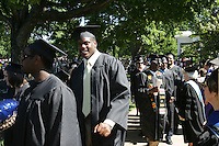 UVa football player at 2006 Graduation. Photo/Andrew Shurtleffgraduate celebrate happy