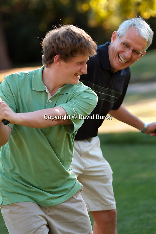 Father and son golfing