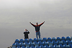 Faroe Islands 0 Scotland 2, 06/06/2007. Svangaskard, Toftir, Euro 2008 Qualifying. A Scotland fan celebrating his team's victory on an embankment behind the goal at the end of the Faroe Islands match with Scotland in a Euro 2008 group B qualifying match at the Svangaskard stadium in Toftir. The visitors won the match by 2 goals to nil to stay in contention for a place at the European football championships which were to be held in Switzerland and Austria in the Summer of 2008. It was the first time Scotland had won in the Faroes, the previous two matches ended in draws. Photo by Colin McPherson.