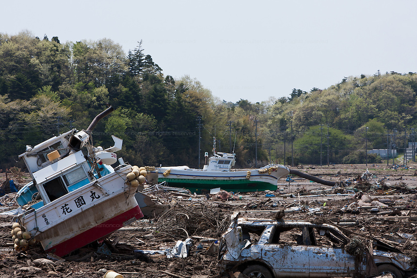 Fishing boats washed up and damaged by the March 11th tsunami in rice fields in Kashimaku Oshimada, Fukushima, Japan. Wednesday May 4th 2011