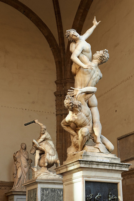 The Rape of the Sabine Women by the Flemish artist Jean de Boulogne ( Giambologna). Made from one imperfect block of white marble, the largest block ever transported to Florence. The Loggia dei Lanzi, also called the Loggia della Signoria, Piazza della Signoria in Florence, Italy,