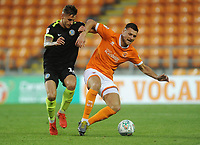 Blackpool's Ryan Edwards under pressure from Macclesfield Town's Jacob Blyth<br /> <br /> Photographer Kevin Barnes/CameraSport<br /> <br /> The Carabao Cup First Round - Blackpool v Macclesfield Town - Tuesday 13th August 2019 - Bloomfield Road - Blackpool<br />  <br /> World Copyright © 2019 CameraSport. All rights reserved. 43 Linden Ave. Countesthorpe. Leicester. England. LE8 5PG - Tel: +44 (0) 116 277 4147 - admin@camerasport.com - www.camerasport.com