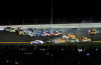 Jul. 2, 2011; Daytona Beach, FL, USA; NASCAR Sprint Cup Series drivers Mark Martin (5), Martin Truex Jr (56), Travis Kvapil (38), Clint Bowyer (33), Joe Nemechek (87), Landon Cassill (51), Regan Smith (78), Tony Stewart (14) and Brian Vickers (83) crash during the Coke Zero 400 at Daytona International Speedway. Mandatory Credit: Mark J. Rebilas-
