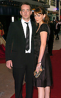 MATTHEW MacFADYEN & KEELEY HAWES.Pride & Prejudice UK film premiere at the Odeon Leicester Square, London.September 5th, 2005.half length couple boyfriend girlfriend clutch purse black dress suit.www.capitalpictures.com.sales@capitalpictures.com.©Capital Pictures