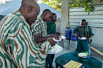 Anti-poaching scouts eating breakfast before deployment, Kafue National Park, Zambia