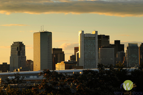 Federal Reserve Bank of Boston building and accompanying skyline at dusk.