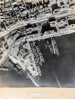BNPS.co.uk (01202 558833)<br /> Pic: PhilYeomans/BNPS<br /> <br /> Naples after Allied bombers arrived.<br /> <br /> Unearthed - fascinating unseen archive of cameras, photographs, documents and medals from a British aerial reconnaisance expert who fought all the way through Africa and southern Europe in WW2.<br /> <br /> Flt Lt Eric Cooper from London kept all his wartime paraphernalia, including his K20 handheld camera and stereoscopic plotting instruments until his death in Devon aged 96 in 2012.<br /> <br /> The incredible photographs show bombing raids, amphibious landings and badly damaged aircraft alongside off duty snaps of the campaign throughout the mediterraenean.<br /> <br /> His nephew is now selling the compelling collection at Plymouth Auction Rooms in Devon next week.