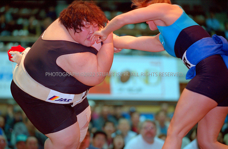 10/26/2001--Hirosaki, Aomori Prefecture, Japan..Rie Tsuihij hits the ground  at the World internationl sumo tournament...All photographs ©2003 Stuart Isett.All rights reserved.This image may not be reproduced without expressed written permission from Stuart Isett.