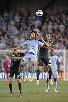 Zach Scott (20) defender Seattle Sounders goes up for a header with Roger Espinoza..Sporting Kansas City defeated Seattle Sounders on penalty kicks, after a 1-1 tied game to win the Lamar Hunt Open Cup at LIVESTRONG Sporting Park, Kansas City, Kansas..