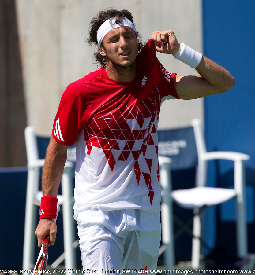 JUAN MONACO (ARG) against RADEK STEPANEK (CZE) (23) in the 2nd round of the Men's Singles. Juan Monaco beat Radek Stepanek 6-4 6-1 2-0 after Stepanek retired ..Tennis - Grand Slam - US Open - Flushing Meadows - New York - Day 04 - September 1st  2011..© AMN Images, Barry House, 20-22 Worple Road, London, SW19 4DH, UK..+44 208 947 0100.www.amnimages.photoshelter.com.www.advantagemedianetwork.com.