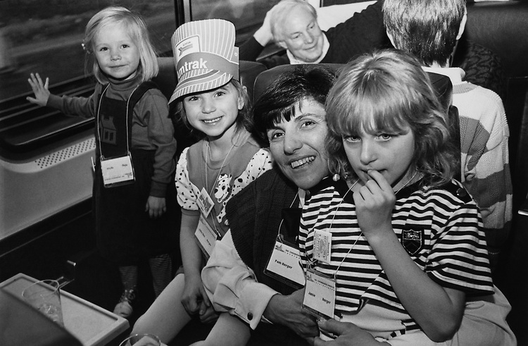Meg Upton (age 3), Julie Herger (age 5), Pam Herger and Jamie Herger (age 7), Rep. Jim Leach, R- Iowa, in background wearing Amtrak Engineer's Cap on the Train ride to Princeton for Republican Retreat on March 14, 1991. (Photo by Laura Patterson/CQ Roll Call via Getty Images)