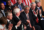 United States Representative Barney Frank (D-MA) (3rd R) and U.S. Senator Chris Dodd (D-CT) (5th L) shake hands after being thanked by U.S. President Barack Obama before he signed the Dodd-Frank Wall Street Reform and Consumer Protection Act at the Ronald Reagan Building, Wednesday, July 21, 2010 in Washington, DC. The bill is the strongest financial reform legislation since the Great Depression and also creates a consumer protection bureau that oversees banks on mortgage lending and credit card practices.  .Credit: Win McNamee - Pool via CNP