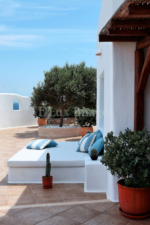 cycladic terrace with built-in bed