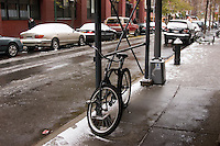New York, NY - 2 December 2007 - Bicycle chained to construction scaffolding for lack of adequate bicycle parking.
