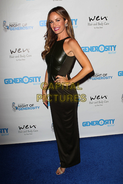 Catt Sadler<br /> Generosity Water's 5th Annual Night Of Generosity Benefit Held at the Beverly Hills Hotel, Beverly Hills, California, USA, <br /> 6th September 2013.<br /> full length dress black leather sleeveless smiling pink purple lipstick makeup long maxi hand on hip side <br /> CAP/ADM/KB<br /> &copy;Kevan Brooks/AdMedia/Capital Pictures
