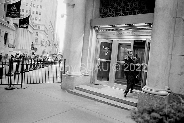 New York, New York<br /> March 17, 2008 <br /> <br /> Exiting the New York Stock Exchange as markets continue to swing at 100+ points a day up or down. The mortgage crisis was playing out on Wall Street. The previous day the Federal Reserve bailed out a major US bank - Bear Stearns with a $30 billion investment along side JP Morgan.