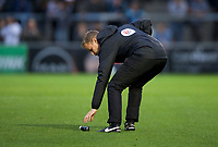 The forth official picks up the spray can dropped by Referee Gavin Ward during the Carabao Cup match between Wycombe Wanderers and Fulham at Adams Park, High Wycombe, England on 8 August 2017. Photo by Alan  Stanford / PRiME Media Images.