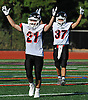 Mount Sinai No. 21 Michael Carniero, left, and No. 37 Jason Shlonsky raise their arms in triumph after their team's 19-15 win over Babylon in a Suffolk County Division IV varsity football game at Islip High School on Saturday, September 5, 2015.<br /> <br /> James Escher