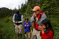 Ken Leghorn and daughter Yanna and Ken Rait and daughter Maya hike near Moser Island.. Ground truthing espedition by Bob Christensen,Richard Carstensen, Keynon Fields and Eric Ringler, to see investigating past and proposed timber projects in the Tongass National Forest.  Looking at the past and trying to determine the effect of proposed cuts..The group downloads information that was collected from field notes, pictures and information from wireless GPS units they wear in their hats as they hike through the forest and estuaries.   They are mapping the forest, uncut, proposed cut and old logging sites to see what is there...The group camped on to Moser Island camp site..Central Chichagof Island -- old growth forest and a hike through the alluvial forest.  Pictures of spruce trees--approximately 200 years old and a 50 foot waterfall.
