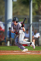 Northeastern Huskies shortstop Spenser Smith (22) bunts during a game against the South Dakota State Jackrabbits on February 23, 2019 at North Charlotte Regional Park in Port Charlotte, Florida.  Northeastern defeated South Dakota State 12-9.  (Mike Janes/Four Seam Images)