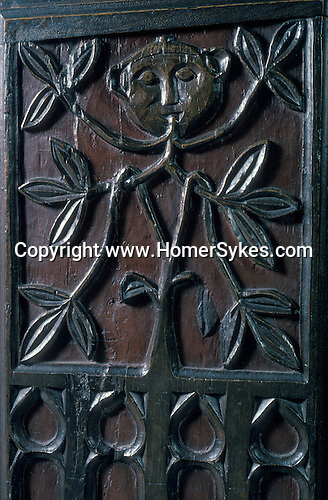 Green Man church bench end. 16th century. 'The Church of The Holy Ghost', Crowcombe, Somerset, England. Mysterious Britain published by Orion<br /> The Greenman figure is a symbolic of fertility.
