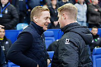 (L-R) Sheffield Wednesday manager Garry Monk greets former team mate Alan Tate during the Sky Bet Championship match between Sheffield Wednesday and Swansea City at Hillsborough Stadium, Sheffield, England, UK. Saturday 09 November 2019