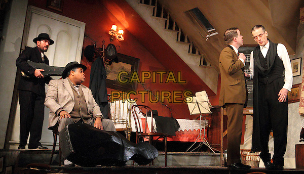 Clive Rowe, Peter Capaldi, Ben Miller and Stephen Wight.'The Ladykillers' cast photocall for new production at the Gielgud Theatre, Shaftesbury Avenue, London, England..December 5th 2011.stage acting performance performing sitting black suit full length white shirt.CAP/ROS.©Steve Ross/Capital Pictures