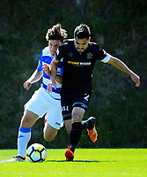 Justin Gulley (right) tackles Abdullah Al-Kalisy during the ISPS Handa Premiership football match between Team Wellington and Tasman United at David Farrington Park in Wellington, New Zealand on Sunday, 12 November 2017. Photo: Dave Lintott / lintottphoto.co.nz