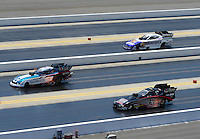 Apr. 14, 2012; Concord, NC, USA: NHRA funny car drivers (top to bottom) Matt Hagan , Tim Wilkerson and Blake Alexander race three wide during qualifying for the Four Wide Nationals at zMax Dragway. Mandatory Credit: Mark J. Rebilas-
