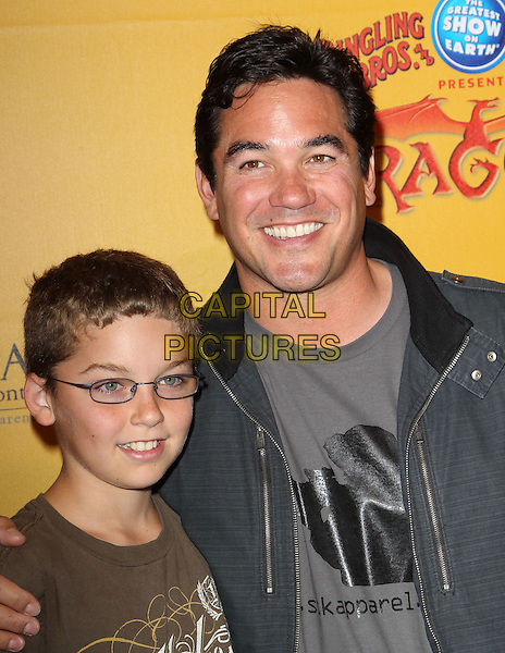 "Dean Cain with his son Christopher Cain.Los Angeles Premiere Of Ringling Bros. And Barnum & Bailey ""DRAGONS"" Held at The Staples Center, Los Angeles, California, USA..July 12th, 2012.headshot portrait father dad kid child family glasses grey gray shirt top  .CAP/ADM/KB.©Kevan Brooks/AdMedia/Capital Pictures."