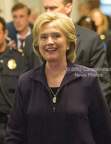 Former United States Secretary of State Hillary Rodham Clinton, a candidate for the 2016 Democratic Party nomination for President of the United States, smiles as she departs after giving testimony before the US House Select Committee on Benghazi on Capitol Hill in Washington, DC on Thursday, October 22, 2015.<br /> Credit: Ron Sachs / CNP<br /> (RESTRICTION: NO New York or New Jersey Newspapers or newspapers within a 75 mile radius of New York City)
