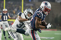 FOXBOROUGH, MA - NOVEMBER 24: New England Patriots Wide Receiver N'Keal Harry #15 catches a pass for a touchdown during a game between Dallas Cowboys and New England Patriots at Gillettes on November 24, 2019 in Foxborough, Massachusetts.