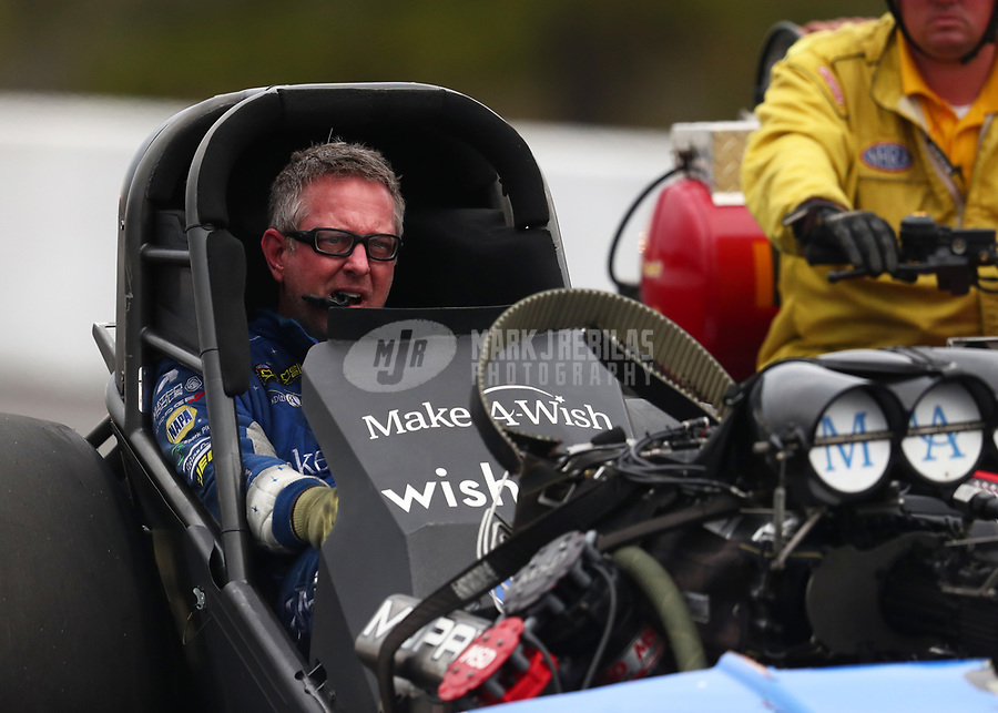 Mar 16, 2019; Gainesville, FL, USA; NHRA funny car driver Tommy Johnson Jr reacts after exploding the body off his car during qualifying for the Gatornationals at Gainesville Raceway. Johnson was uninjured in the explosion. Mandatory Credit: Mark J. Rebilas-USA TODAY Sports