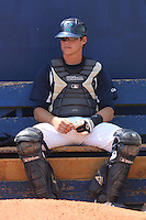 UNC-Wilmington catcher Cody Stanley #8 sits in the bullpen before a   game vs. the George Mason University Patriots at Brooks Field in Wilmington, North Carolina on April 4, 2010. UNCW won the game 5-4.  Photo By Robert Gurganus/Four Seam Images