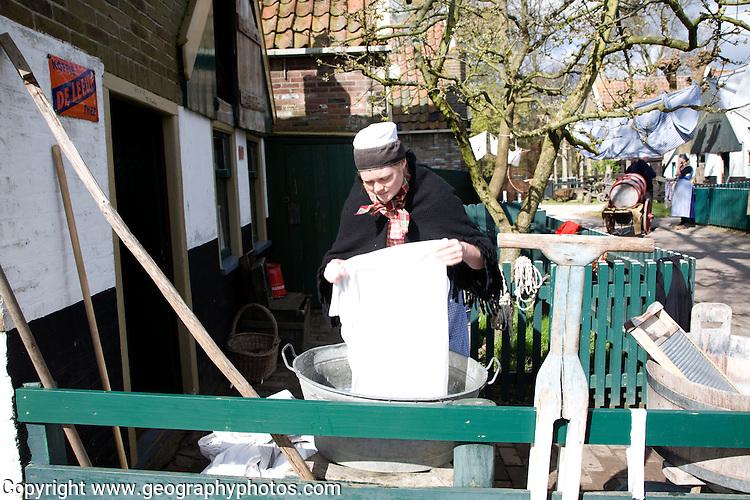 Urk village woman washing by hand, Zuiderzee museum, Enkhuizen, Netherlands