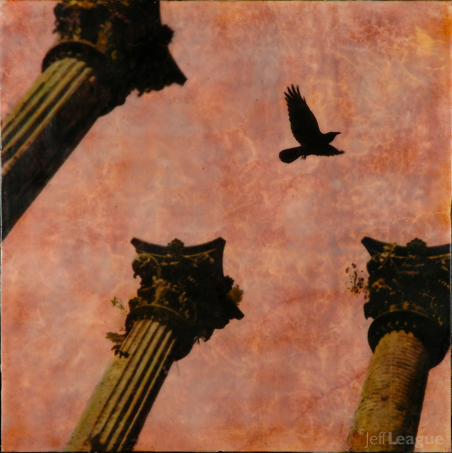 Mixed media encaustic photo painting of architectural collage with columns and crow in sunset sky.