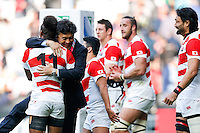 Japan Winger Kotaro Matsushima and the Japanese players and staff celebrate after Japan win the match - Mandatory byline: Rogan Thomson - 03/10/2015 - RUGBY UNION - Stadium:mk - Milton Keynes, England - Samoa v Japan - Rugby World Cup 2015 Pool B.