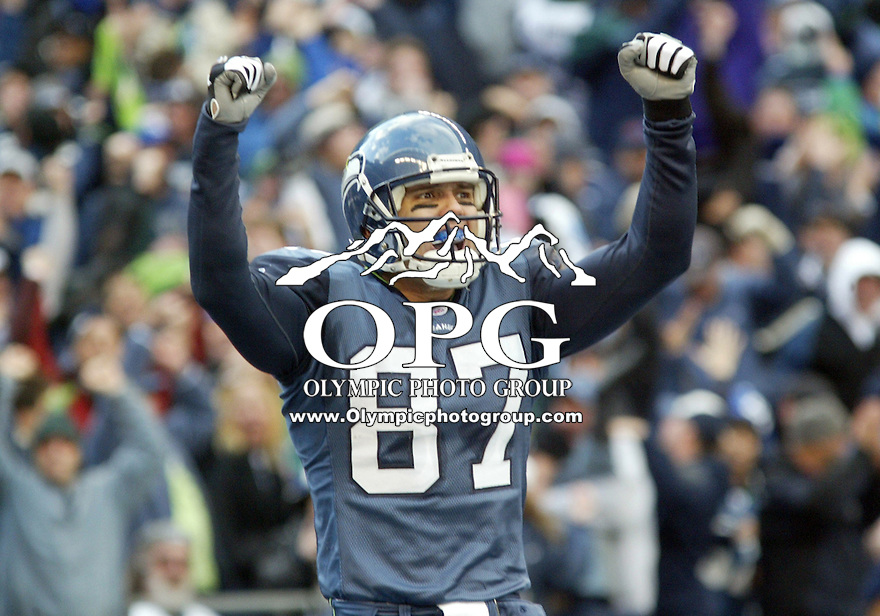 Seattle Seahawks wide receiver Joe Jurevicius celebrates after catching a  Matt Hasselbeck pass for a  first quarter touch down.  Jurevicius  had two touch downs and was 8 for 137 yards on the day against the New York Giants at Quest Field in Seattle, WA.