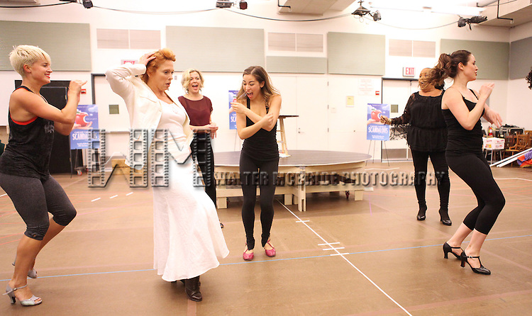 Actress Carolee Carmello  with ensemble cast performing at the rehearsal presentation for 'Scandalous The Musical' at the New 42nd Street Studios on Monday, Sept. 24, 2012 in New York.