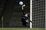 06 December 2014: North Carolina's Brendan Moore makes a save on UCLA's first penalty kick in the shootout. The attempt was taken by UCLA's Brian Iloski (not pictured). The University of California Los Angeles Bruins hosted the University of North Carolina Tar Heels at Drake Stadium in Los Angeles, California in a 2014 NCAA Division I Men's Soccer Tournament Quarterfinal round match. The game ended in a 3-3 tie after two overtimes. UCLA advanced to the next round by winning the penalty kick shootout 7-6.