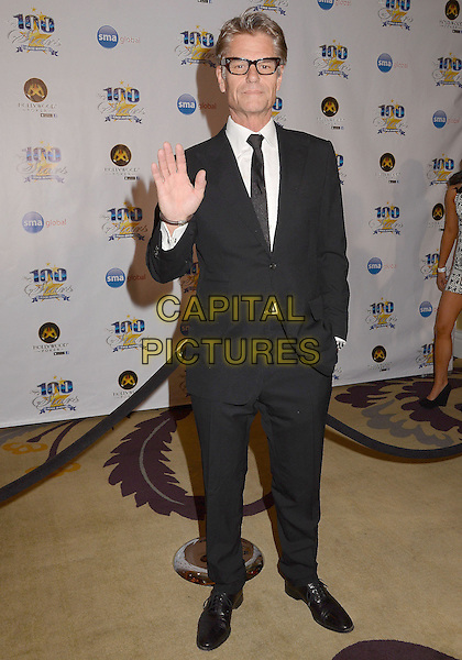 Harry Hamlin.23nd Annual Night of 100 Stars Awards Gala hosted by Norby Walters celebrating the 85th Annual Academy Awards held at the Beverly Hills Hotel, Beverly Hills, California, USA..February 24th, 2013.full length black suit glasses hand palm waving .CAP/ADM/BT.©Birdie Thompson/AdMedia/Capital Pictures.