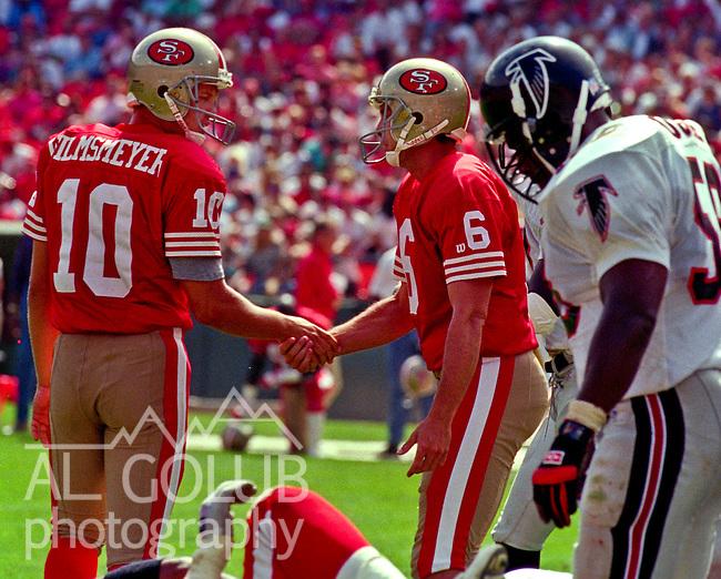 San Francisco 49ers vs. Atlanta Falcons at Candlestick Park Sunday, September 19,1993.  49ers beat Falcons 37-30.  San Francisco 49ers Punter Klaus Wilmsmeyer (10) congratulates kicker Mike Cofer (6) on successful field goal.