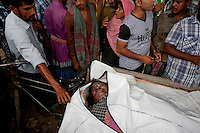 A dead body is exposed for identification.  The Pinak-6, a passenger vessel sank in the middle of the river Padma on its way to Mawa from Kawrakandi terminal at around 11 PM today. The boat capsized since the river was rough due to the stormy weather. At least 250 people were in the capsized boat. Local people rescued nearly 45 passengers from the river and many other are still missing. Stormy weather and strong current hamper the rescue operation. Mawa, Munshigonj, near Dhaka, Bangladesh