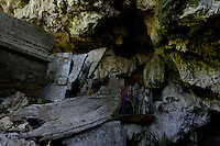 wooden, carved coffins in a holy cave in Toraja land, Sulawesi, Indonesia. The old coffins are shaped like a boat, scientists and local people believe, ancestors of the Torajas came by boat to Sulawesi, shaping houses and coffins like boats in memory of their origin.
