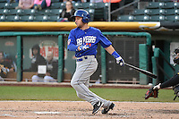 Daniel Muno (12) of the Las Vegas 51s at bat against the Salt Lake Bees at Smith's Ballpark on May 8, 2014 in Salt Lake City, Utah.  (Stephen Smith/Four Seam Images)