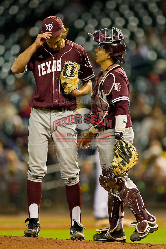 Catcher Kevin Gonzalez #10 of the Texas A&M Aggies has a chat with starting pitcher Michael Wacha #38 during the game against the Rice Owls at Minute Maid Park on March 5, 2011 in Houston, Texas.  Photo by Brian Westerholt / Four Seam Images