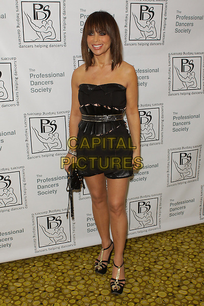 "PAULA ABDUL.""The Professional Dancers Society Fall Ball"" held at The Sportsmen's Lodge, Studio City - California, USA..October 16th, 2009.full length black strapless top shorts playsuit clutch bag platform sandals shoes .CAP/ADM/TC.©T. Conrad/AdMedia/Capital Pictures."