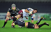 Louis Madaule of Bordeaux Begles is tackled by Nicky Smith of the Ospreys. European Rugby Champions Cup match, between the Ospreys and Bordeaux Begles on December 12, 2015 at the Liberty Stadium in Swansea, Wales. Photo by: Patrick Khachfe / JMP